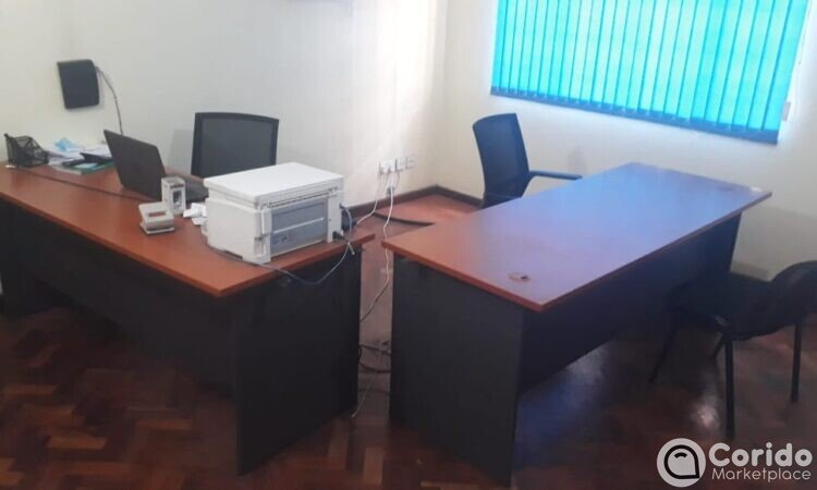 office-furniture-clearance-sale. Two office desk, two chairs, a printer and laptop on top